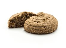 Cocoa oat cookie isolated on white. Cocoa oat cookie cracked in two halves isolated on white background drop shape brown crispy biscuit Stock Photos