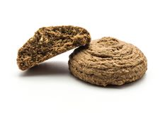 Cocoa oat cookie isolated on white. Cocoa oat cookie one cracked half isolated on white background drop shape brown crispy biscuit Stock Images