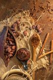 Cocoa pod ,beans and cocoa nibs setup on rustic wooden background. Agriculture aroma aromatic botanical bowl butter cacao chocolate composition cooking cut royalty free stock image