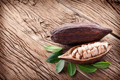 Cocoa pod. On a dark wooden table stock photo