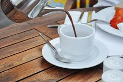 Cocoa poured into white cup Stock Photo