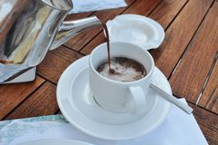 Cocoa poured into white cup Stock Images