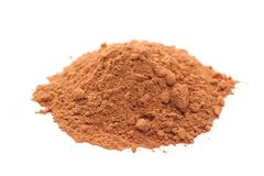 Cocoa powder. Spilled cocoa powder. Focus on the center of the image Royalty Free Stock Photos