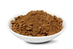 Cocoa Powder. In small white bowl, isolated on white background Royalty Free Stock Images