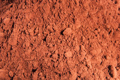 Cocoa Powder. Brown cocoa powder sprinkled on a shelf Stock Image