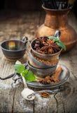 Cocoa powder, anise, sugar, vanilla pods in Stock Photos