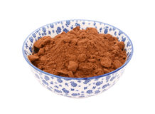 Cocoa powder in a blue and white china bowl Stock Photography