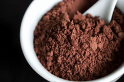 Cocoa powder in a bowl. Close up Stock Photo