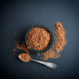 Cocoa powder in a bowl with spoon Stock Image