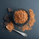 Cocoa powder in a bowl Royalty Free Stock Photos
