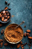 Cocoa powder and cacao beans on dark background Stock Photo
