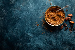 Cocoa powder and cacao beans on dark background Stock Image