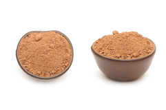 Cocoa powder in a clay bowl Royalty Free Stock Photos