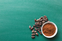 Cocoa powder and cooa beans Royalty Free Stock Image