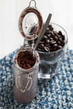 Cocoa powder in glass jar Royalty Free Stock Photo
