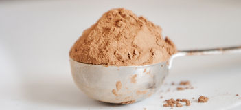 Cocoa powder isolated on white background Royalty Free Stock Photos