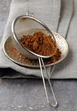 Cocoa powder in a metal sieve Stock Images