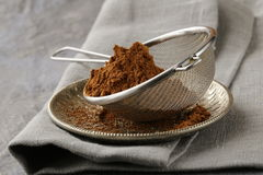 Cocoa powder in a metal sieve Stock Image
