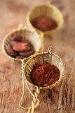 Cocoa powder  in old rustic style silver sieves Stock Photos