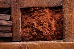 Cocoa powder in old spicy box Royalty Free Stock Photo