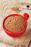 Cocoa powder in a red cup Stock Image