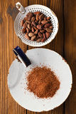 Cocoa powder and roasted cocoa chocolate beans Royalty Free Stock Image