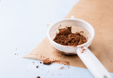 Cocoa powder in sieve Stock Photo