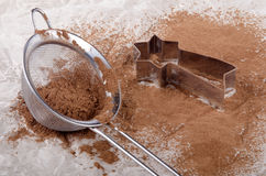 Cocoa powder in a sieve and cookie cutter Stock Photo