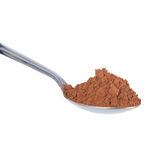 Cocoa powder. In a spoon isolated on white background Stock Photography