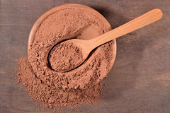 Cocoa powder in a spoon Royalty Free Stock Images