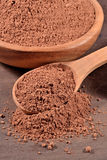 Cocoa powder in a spoon Royalty Free Stock Photography