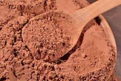 Cocoa powder in a spoon Stock Photos