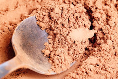 Cocoa  powder  and  steel  spoon Stock Photography