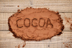 Cocoa powder on wood Stock Photos
