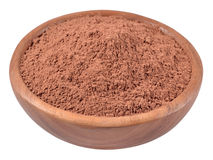Cocoa powder in a wooden bowl on a white Stock Photography