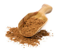 Cocoa powder in a wooden scoop. Isolated on white Stock Photo