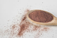 Cocoa powder in wooden spoon. On  grey background Stock Photography