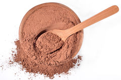 Cocoa powder in a wooden spoon on a white Royalty Free Stock Image