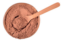 Cocoa powder in a wooden spoon on a white Stock Photo