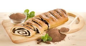 Cocoa Roll. Slices of cocoa roll on a cutting board Royalty Free Stock Image