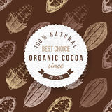 Cocoa round label with type design. Organic cocoa round label with type design on seamless cocoa background Royalty Free Stock Photos