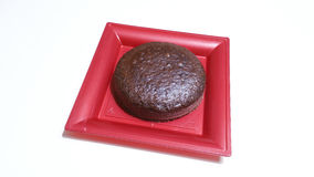 Cocoa sponge cake. In a red tray Stock Images
