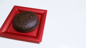 Cocoa sponge cake. In red tray Stock Photography