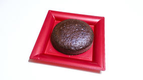 Cocoa sponge cake. In red tray Royalty Free Stock Images