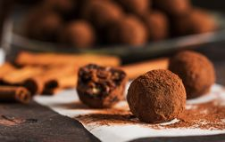 Cocoa Truffles on Rustic Background. Delicious Cocoa Truffles and Coffee on Rustic Background stock images