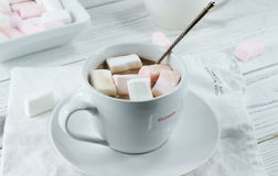 Cocoa with white rose marshmallow. Cocoa with marshmallow on white background Royalty Free Stock Images