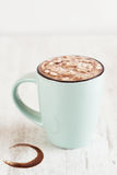 Cocoa wiht melted marshmallow in light blue cup on white backgro Royalty Free Stock Images