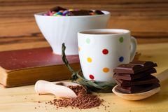 Cocoa in wooden spoon and chocolate Stock Image