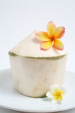Coconut. Young coconut with two lan thom flowers Stock Images