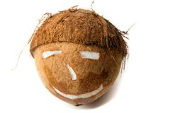 Coconut. Face shaped cut coconut on a white background Royalty Free Stock Photography
